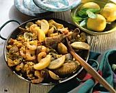 Paella in the pan; lemons