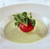 Creamed corn salad soup with tomato and goat's cheese