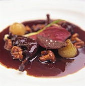 Pink roast pigeon with chanterelles in red wine sauce