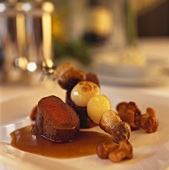 Venison medallions with chanterelles and skewered ceps