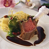 Lamb with wasabi pesto and parsnips on plate