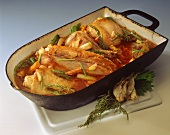 Rabbit in red wine in roasting dish