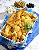 Pan-cooked chicken dish with onions, lemons and potatoes