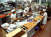 Pastry chefs baking gateaux and cakes