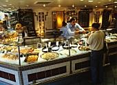 Customer buying fish in a fishmonger's