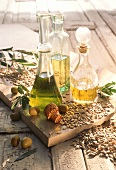 Various oils in carafes: olives; sunflower seeds