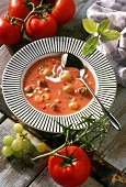 Game soup with tomatoes and grapes