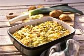 Potato and leek gratin in baking dish
