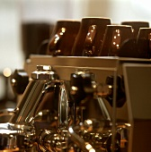 Brown cups on an espresso machine
