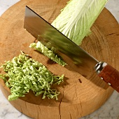 Chopping Chinese cabbage into fine strips