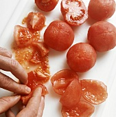 Cutting up cooked tomatoes