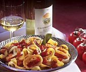Tagliatelle with cuttlefish, peppers and tomatoes