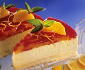 Campari and orange cheesecake with mint leaves