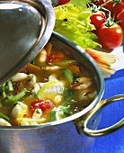 Fish soup with vegetables in soup pot