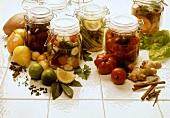 Sweet and sour preserves in jars; various ingredients