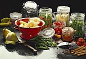 Bottled fruit and vegetables in jars; pears in sieve