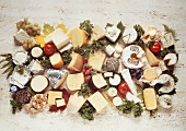 Various different cheeses on stone background