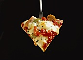 A piece of Pizza Romana with peppers and cheese on server
