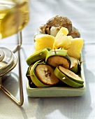 Creole fondue with bananas, pineapples and shrimps