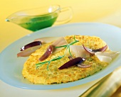 Rosti with shallots on plate; parsley sauce