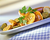 Vienna sausages with fried potatoes and gherkins