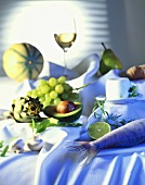 Still life with fish, vegetables, fruit, cheese & white wine