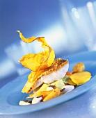 Fried zander fillet on pumpkin with pumpkin seeds