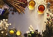 Tea, tea leaves, spices, sugar crystals, lemons and limes