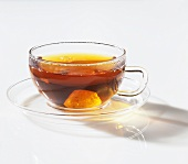 Black tea with crystal sugar in glass cup