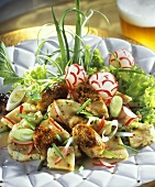 Dumpling salad with radishes, sausage and spring onions