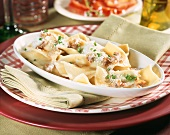 Ravioli with Parmesan and potato filling and walnuts