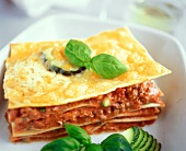 Lasagne with mince and courgette filling and basil