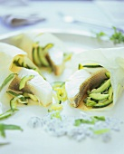 Fish parcels in greaseproof paper with courgettes