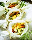 Vegetables cooked in foil on baking sheet