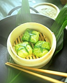 Savoy parcels in bamboo steamer