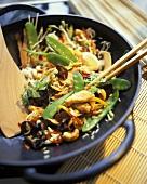 Stir-fry with turkey, vegetables and mushrooms in wok