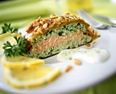 Salmon in puff pastry case with flaked almonds