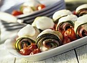 Courgette rolls with mozzarella, tomatoes and ham