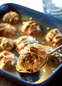 Meat dumplings with bacon in jelly in a roasting dish