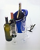 Wine glasses, champagne glass; cooler; corkscrew; wine bottles