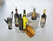 Various wine bottles, wine glasses and accessories