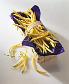 Yellow wax beans in woodchip basket
