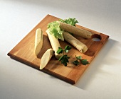 Tofu sausage on wooden chopping board