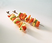 Raw vegetable kebabs on white background