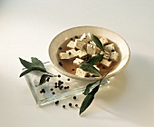 Tofu cube in marinade with peppercorns & bay leaf
