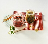 Two chutneys in pickling jars on striped cloth