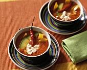 Tomato soup with tortillas, avocado and sheep's cheese