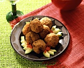 Fried meatballs with avocado and diced tomato