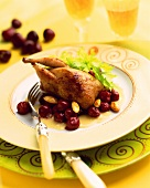 Roast quail with cherry and almond sauce