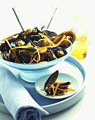 Mussels in white wine sauce with vegetable strips